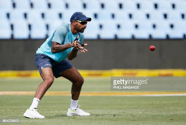 India's Shikhar Dhawan takes part in a training session of the Indian national cricket team at Supersport Park cricket ground on January 12 2018 in...