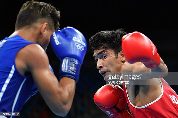 India's Shiva Thapa fights Cuba's Robeisy Ramirez during the Men's Bantam match at the Rio 2016 Olympic Games at the Riocentro Pavilion 6 in Rio de...