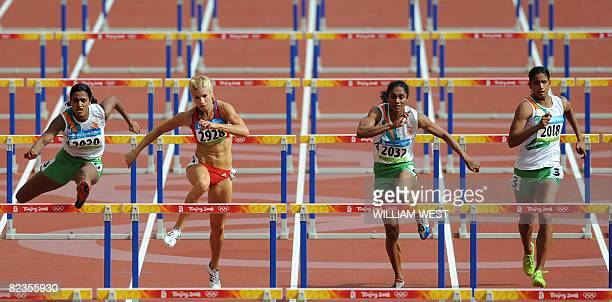 India's Shobha Jagadeeshppa Javur Switzerland's Linda Zublin India's Pramila Ganapathy Gudanda and Susmita Singha Roy compete during the women's...