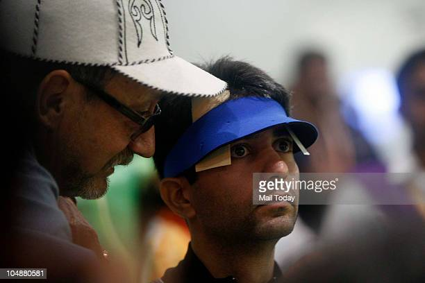 India's shooter Abhinav Bindra aims at the target during the 10M Air Rifle Men event of the Commonwealth Games at DrK Singh Shooting Range in New...