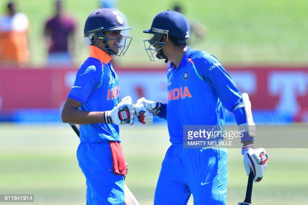 India's Shubman Gill celebrates 100 runs with teammate Ishan Porel during the U19 semifinal cricket World Cup match between India and Pakistan at...