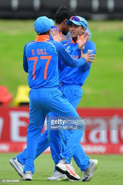 India's Shubman Gill celebrates Australia's Max Bryant being caught with teammate Abhishek Sharma during the U19 World Cup cricket final match...
