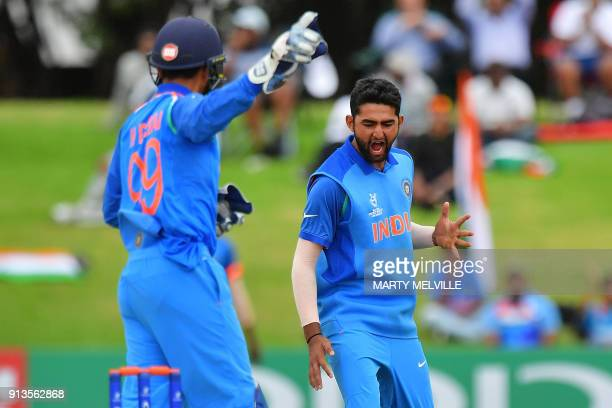 India's Shubman Gill celebrates Australia's Will Sutherland being caught by keeper Harvik Desai during the U19 World Cup cricket final match between...