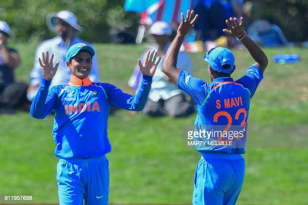 India's Shubman Gill celebrates catching Pakistan's Hassan Khan with teammate Shivam Mavi during the U19 semifinal cricket World Cup match between...