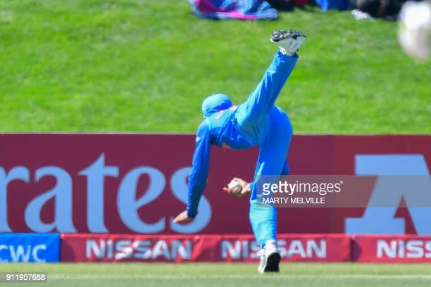 India's Shubman Gill makes a catch to dismiss Pakistan's Hassan Khan during the U19 semifinal cricket World Cup match between India and Pakistan at...