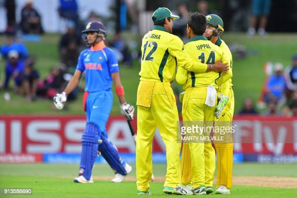 India's Shubman Gill walks off after being stumped as Australian players celebrate during the U19 cricket World Cup final match between India and...