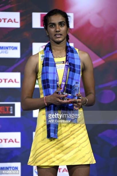 India's Sindhu Pusarla poses with her silver medal on the podium after her defeat to Japan's Nozomi Okuhara in their women's singles final match...