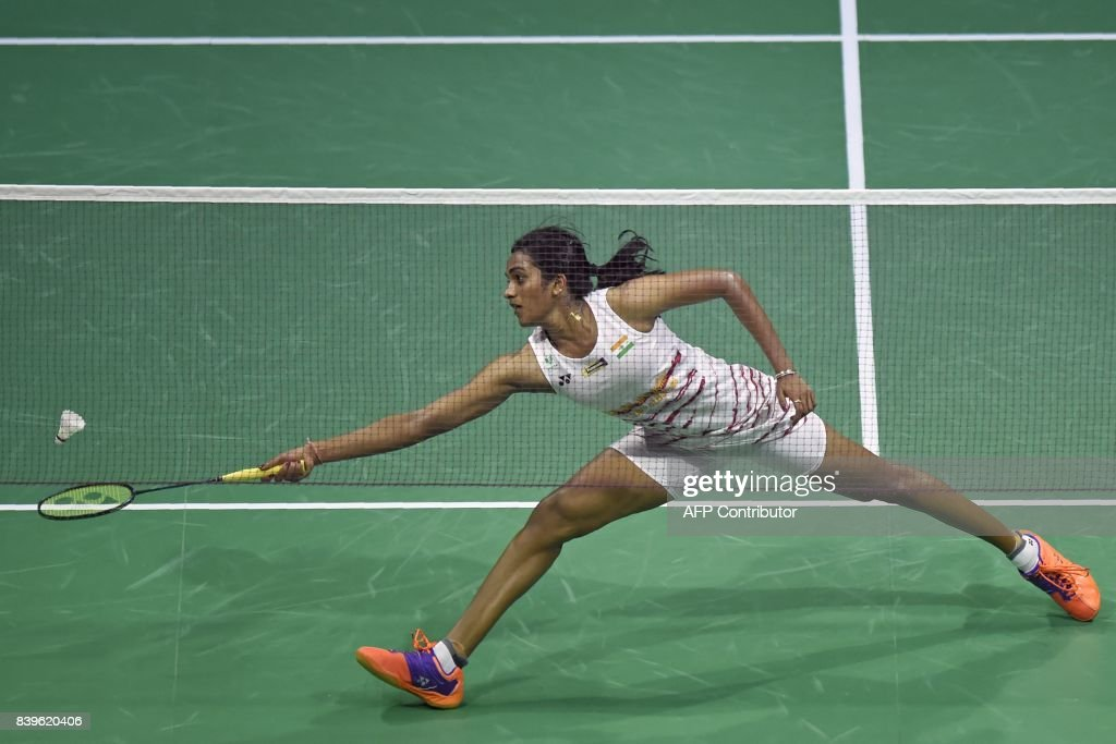 India's Sindhu Pusarla returns against China's Chen Yufei during their semi-final women's singles match during the 2017 BWF World Championships of badminton at Emirates Arena in Glasgow on August 26, 2017. /