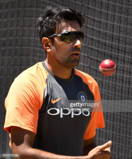 India's spinner Ravi Ashwin tosses the ball up while bowling during a training session in Melbourne on December 24 ahead of the third cricket Test...