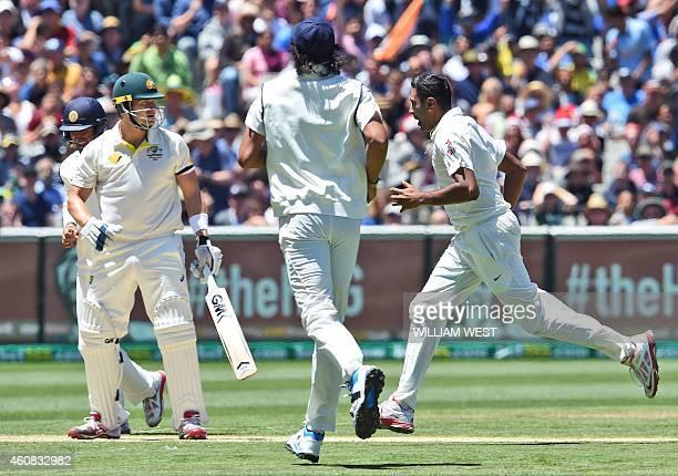 India's spinner Ravichandran Ashwin celebrates dismissing Australia's batsman Shane Watson on the first day of the third cricket Test at the...