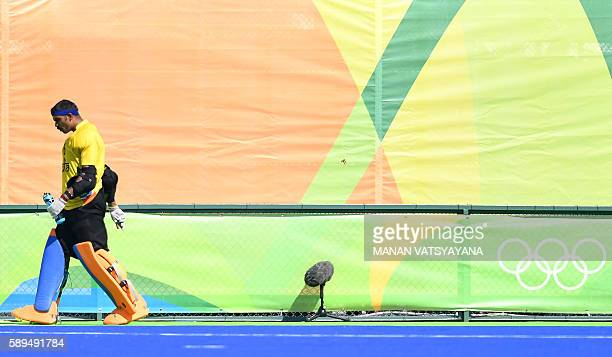 India's Sreejesh Parattu leaves the pitch at the end of the men's quarterfinal field hockey Belgium vs India match of the Rio 2016 Olympics Games at...