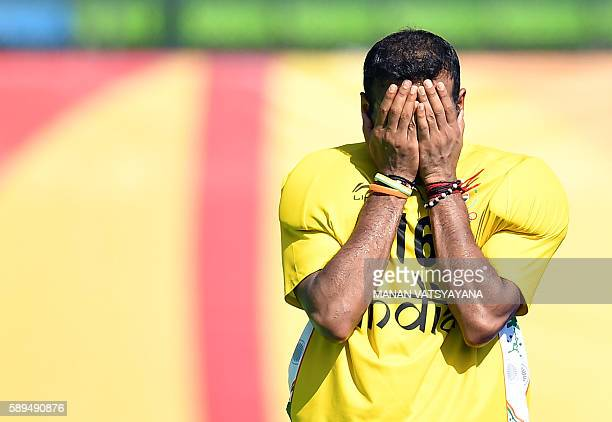 India's Sreejesh Parattu reacts after loosing at the end of the men's quarterfinal field hockey Belgium vs India match of the Rio 2016 Olympics Games...