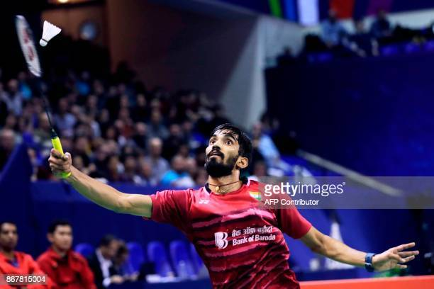 India's Srikanth Kidambi competes against Japan's Kenta Nishimoto during their men's singles final match at the French Open Badminton tournament at...