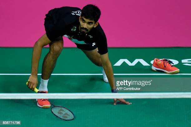 India's Srikanth Kidambi loses her shoe as he returns against South Korea's Son Wan Ho during their quarterfinal men's singles match during the 2017...