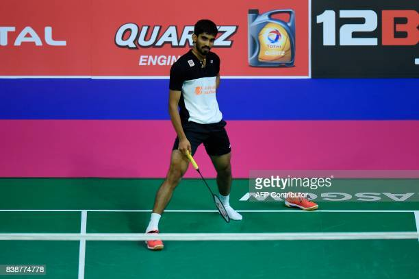 India's Srikanth Kidambi loses his shoe as he returns against South Korea's Son Wan Ho during their quarterfinal men's singles match during the 2017...