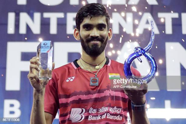 India's Srikanth Kidambi poses with his trophy after winning the men's singles final at the French Open Badminton tournament at the Coubertin Stadium...