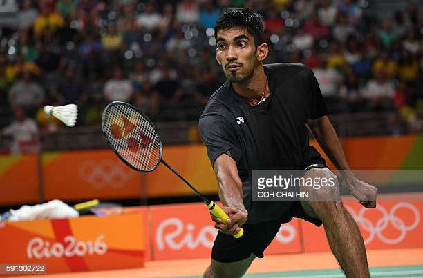 India's Srikanth Kidambi returns against China's Lin Dan during their men's singles quarterfinal badminton match at the Riocentro stadium in Rio de...