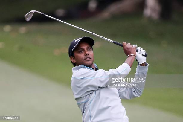 India's SSP Chawrasia hits a shot on the 18th hole during round three of the Hong Kong Open golf tournament at the Hong Kong Golf Club on November 25...