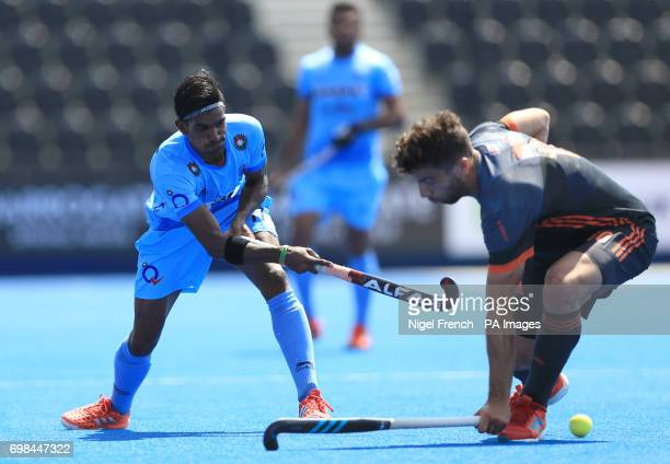 India's Sumit and Netherlands' Valentin Verga battle for the ball during the Men's World Hockey League match at Lee Valley Hockey Centre London