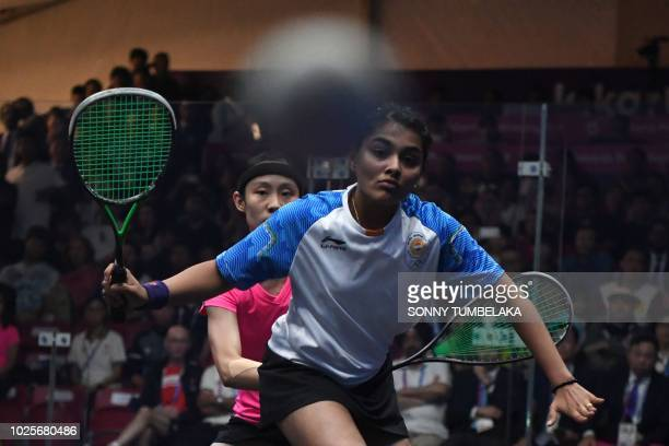Indias Sunayna Kuruvilla hits a return against Hong Kong's Ho Tze Lok in their women's team gold medal squash match at the 2018 Asian Games in...