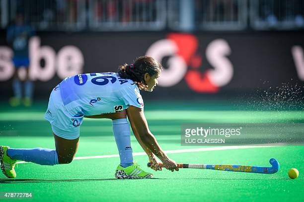 India's Sunita Lakra controls the ball during the semifinal match between Australia and India in Group B of the women's group stage at the World...