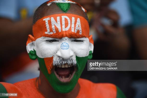 TOPSHOT India's supporters cheer during the 2019 Cricket World Cup group stage match between South Africa and India at the Rose Bowl in Southampton...