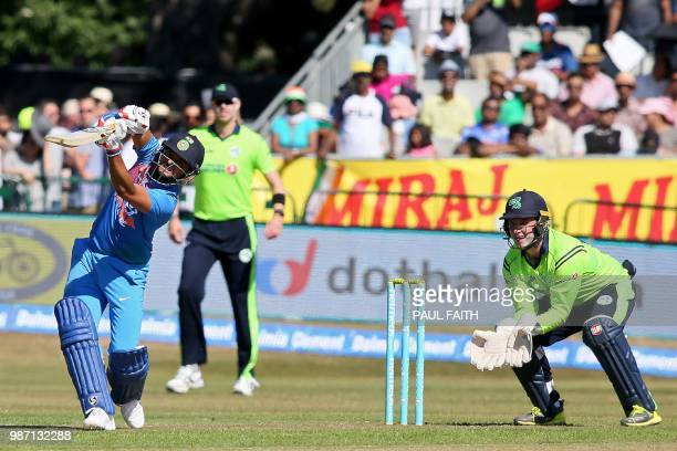 India's Suresh Raina plays a shot as Ireland's Gary Wilson keeps wicket during the Twenty20 International cricket match between Ireland and India at...