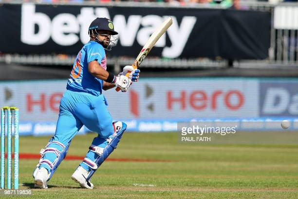 India's Suresh Raina plays a shot during the Twenty20 International cricket match between Ireland and India at Malahide cricket club in Dublin on...
