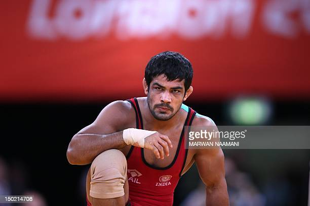 India's Sushil Kumar reacts during his fight against Japan's Tatsuhiro Yonemitsu in their Men's 66kg Freestyle gold medal match on August 12 2012...
