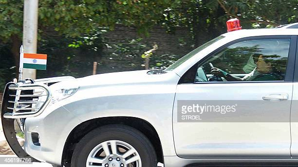 India's Tamil Nadu state Chief Minister Jayalalithaa Jayaram sits in the front passenger seat of a government vehicle as she heads to a court in...