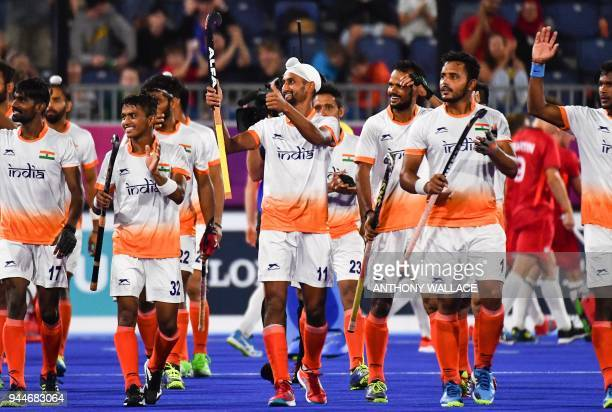 India's team greets the crowd after they won the men's field hockey match between India and England at the 2018 Gold Coast Commonwealth Games on...