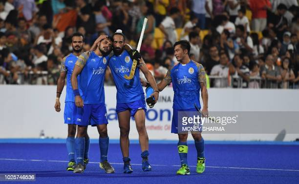 India's team members celebrate after winning the match against Pakistan during the men's field hockey bronze medal match between India and Pakistan...