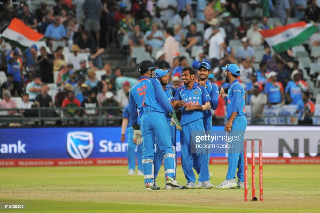 India's team members celebrate the dismissal of Chris Morris for leg before wicket (LBW) during the One Day International (ODI) cricket match between India and South Africa at Newlands Stadium on February 7, 2018, in Cape Town. /