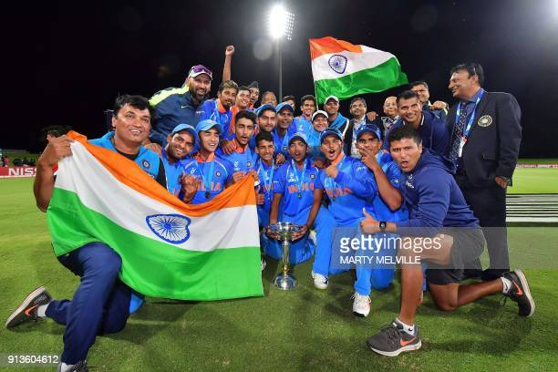 India's team poses as they celebrate their victory in the U19 cricket World Cup final match between India and Australia at Bay Oval in Mount...