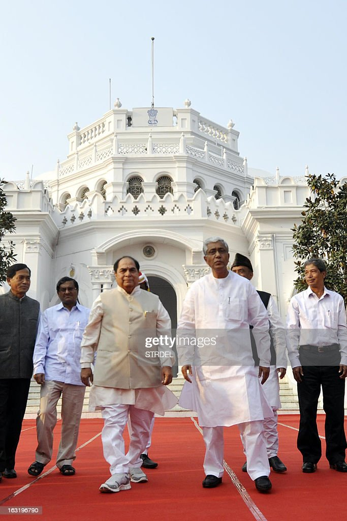 India's Tripura state Governor D.Y. Patil (3rd L) poses with Tripura state Chief Minister Manik Sarkar (3rd R, in white) and other ministers following a swearing-in ceremony at Raj Bhavan in Agartala, capital of India's northeastern state of Tripura, on March 6, 2013. Sarkar is set for his fourth consecutive term as Tripura chief minister after he was unanimously elected as leader of the newly-elected Left Front which won the February 14 polls, a report said.