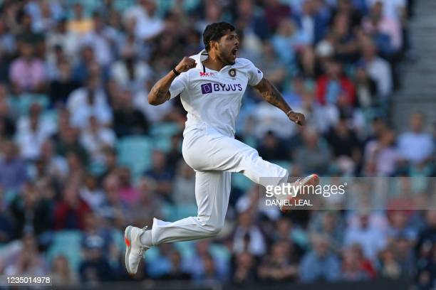 India's Umesh Yadav celebrates after bowling England's captain Joe Root for 21 runs during play on the first day of the fourth cricket Test match...