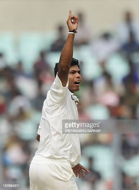 India's Umesh Yadav celebrates after taking the wicket of West Indies cricketer Kraigg Brathwaite during the third day of the second Test cricket...