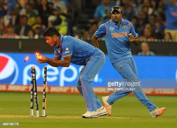 India's Umesh Yadav runs out Bangladesh's Imrul Kayes during the 2015 Cricket World Cup quarterfinal match between India and Bangladesh at the...