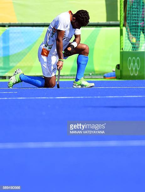 India's Uthappa Sannuvanda kneels on the pitch at the end of the men's quarterfinal field hockey Belgium vs India match of the Rio 2016 Olympics...