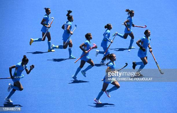India's Vandana Katariya celebrates after scoring the team's third goal against Britain during the women's bronze medal match of the Tokyo 2020...