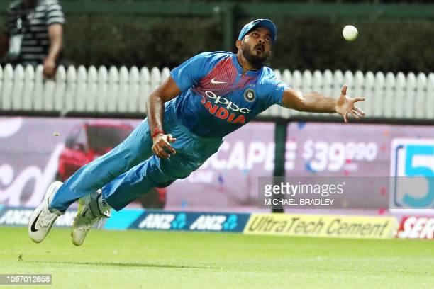 India's Vijay Shankar dives for the ball during the third Twenty20 international cricket match between New Zealand and India in Hamilton on February...