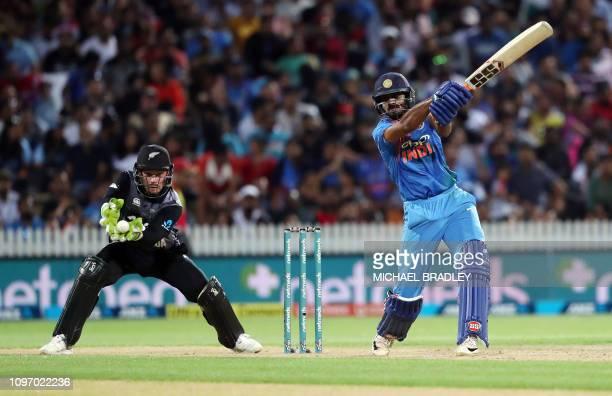 India's Vijay Shankar plays a shot watched by New Zealand's Tim Seifert during the third Twenty20 international cricket match between New Zealand and...