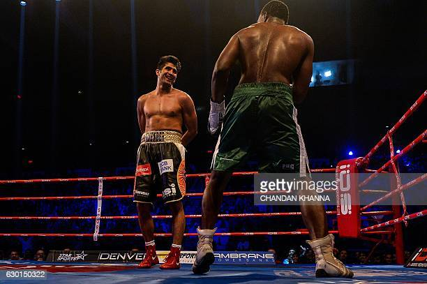 India's Vijender Singh fights with Tanzania's Francis Cheka during their WBO AsiaPacific SuperMiddleweight boxing match at The Thyagaraj Stadium in...
