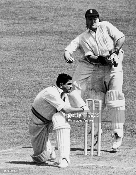 India's Vinoo Mankad sweeps as England wicketkeeper Godfrey Evans catches the ball that didn't arrive