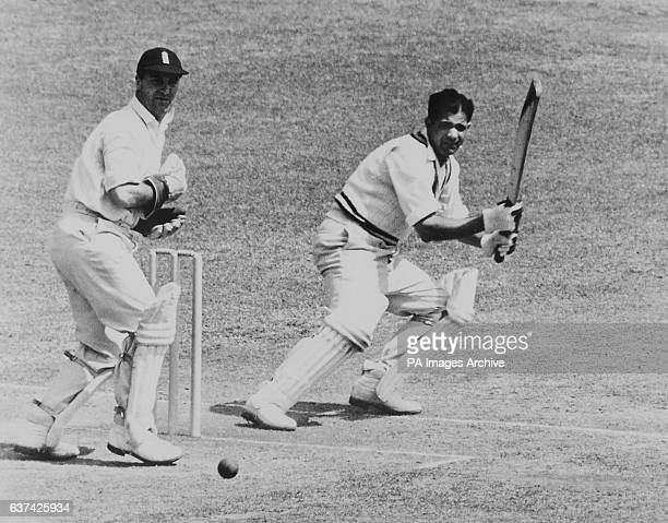 India's Vinoo Mankad turns the ball away through the slips, watched by England wicketkeeper Godfrey Evans