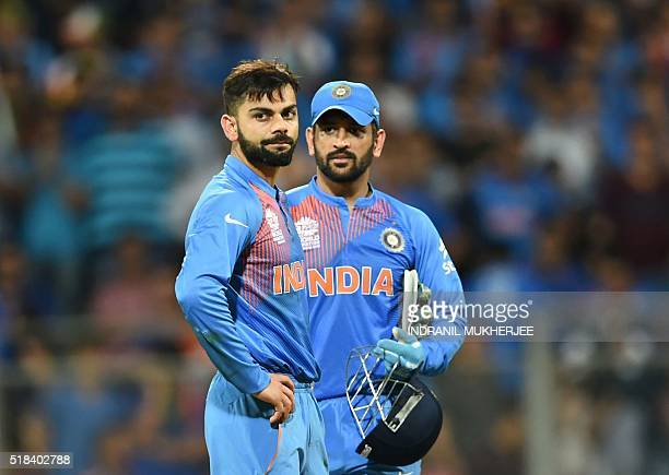 India's Virat Kohli and captain Mahendra Singh Dhoni look on after defeat in the World T20 cricket tournament second semifinal match between India...