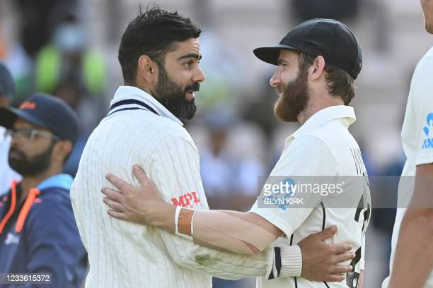 India's Virat Kohli and New Zealand's captain Kane Williamson react before the presentation on the final day of the ICC World Test Championship Final...