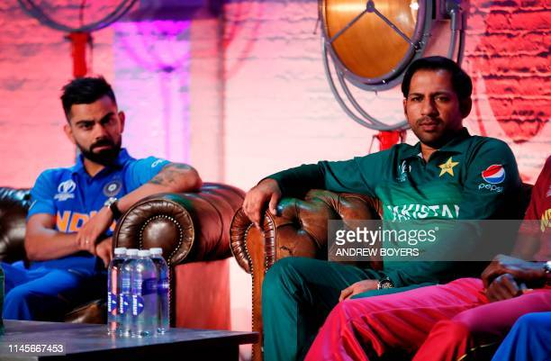India's Virat Kohli and Pakistan's Sarfraz Ahmed take part in a captains press conference ahead of the 2019 ICC Cricket World Cup in London on May 23...