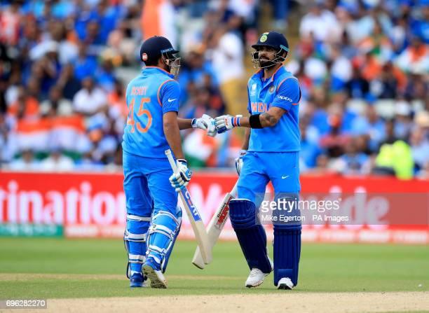 India's Virat Kohli and Rohit Sharma bump gloves during the ICC Champions Trophy semifinal match at Edgbaston Birmingham