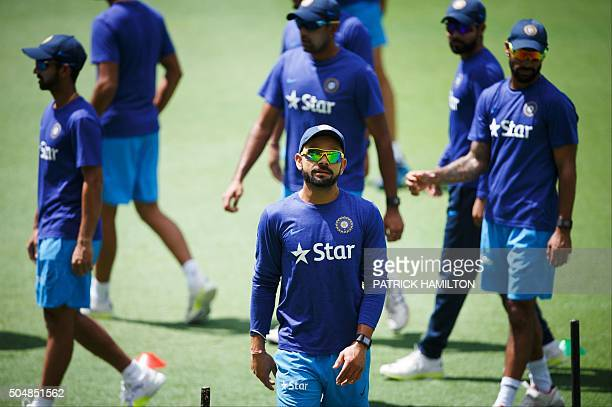 India's Virat Kohli attends a cricket training session in Brisbane on January 14 2016 AFP PHOTO / PATRICK HAMILTON IMAGE RESTRICTED TO EDITORIAL USE...
